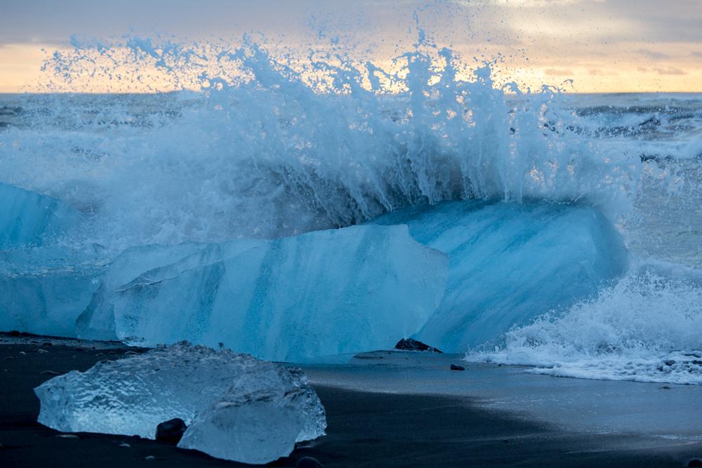 Splashing water on iceberg