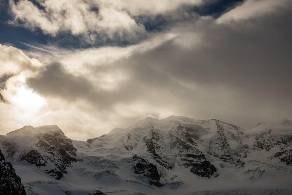 Clouds and sun on Piz Palü