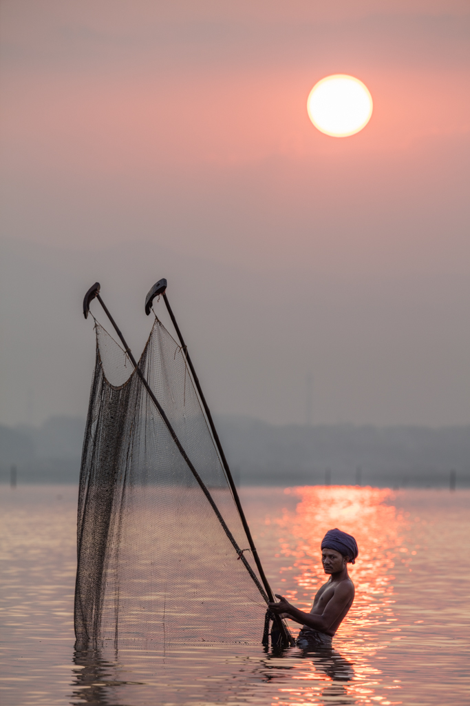 Fisherman at sunrise in Amarapura