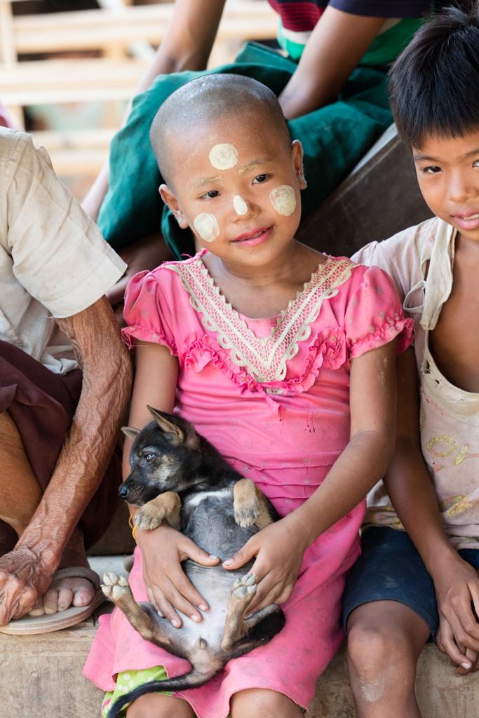 Child with Thanaka face mask