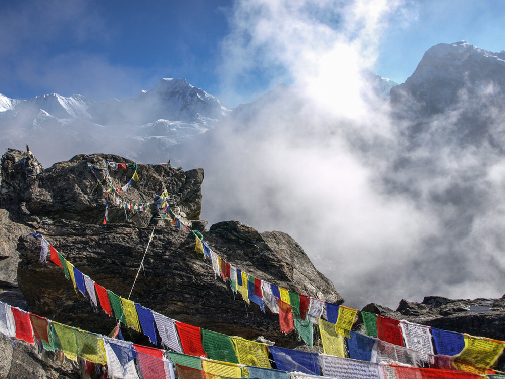 Clouds and prayer flags on Gokyo Re