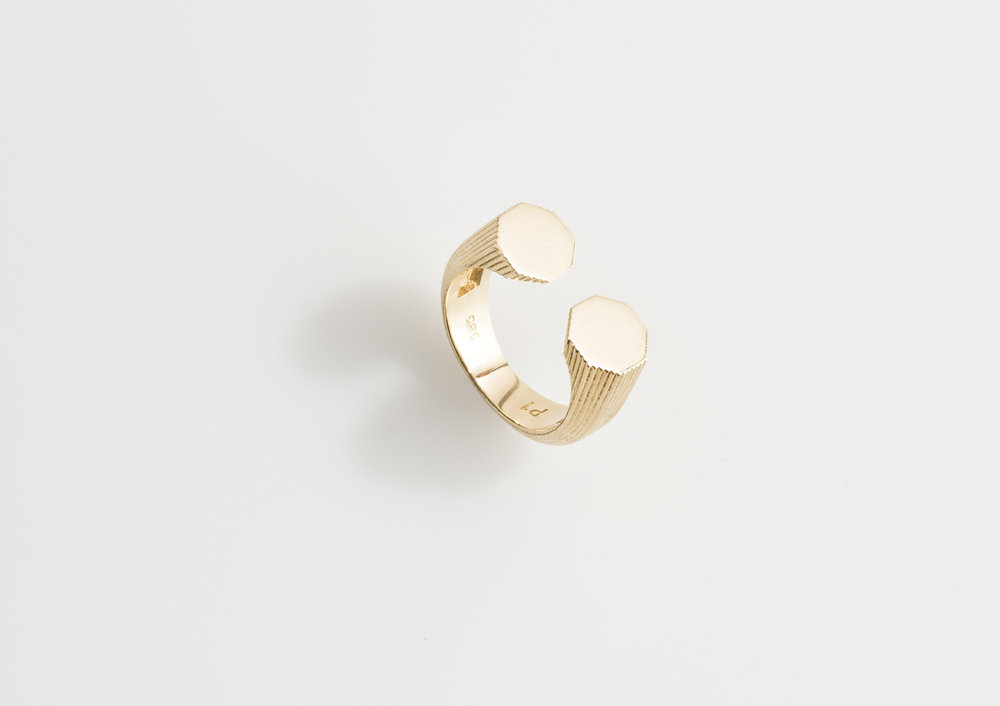 double headed ring with lines.jpg