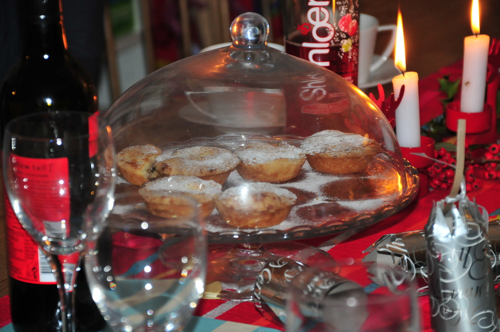 mince pies in a glass cake stand