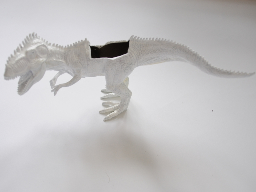White painted dinosaur planter