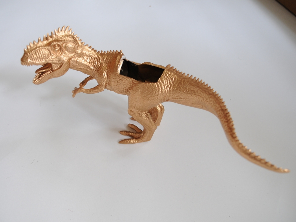 Gold painted dinosaur planter