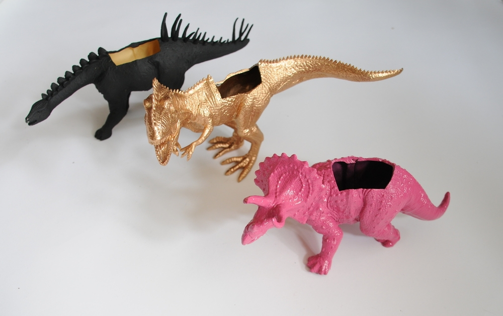 Pink, black and gold painted dinosaur plant pots
