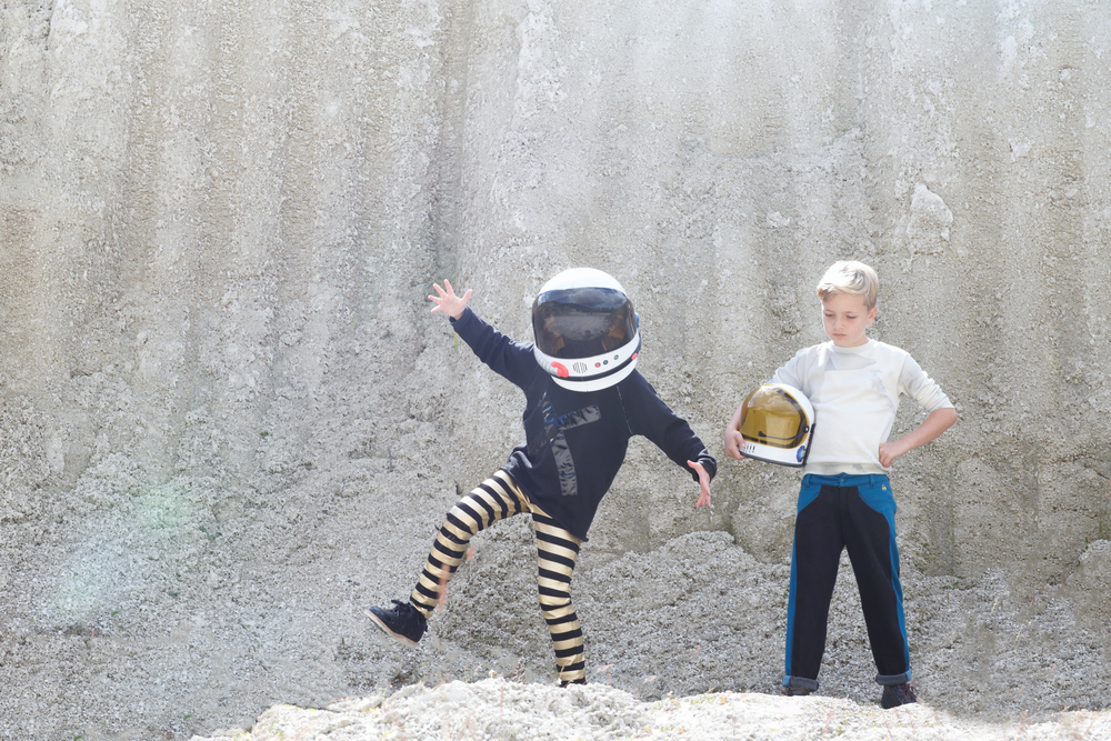 Sam: Plane print sweatshirt, Popupshop. Black trousers with blue stripe, Raspberry Plum. Star & moon socks, Bobo Choses. Blue monkey boots, Young Soles. Helmet, Spacekids.co.uk  Pippa: Black sweatshirt, Loud Apparel. Gold stripe trousers, Molo. Black brogues, Young Soles. Helmet, Spacekids.co.uk.