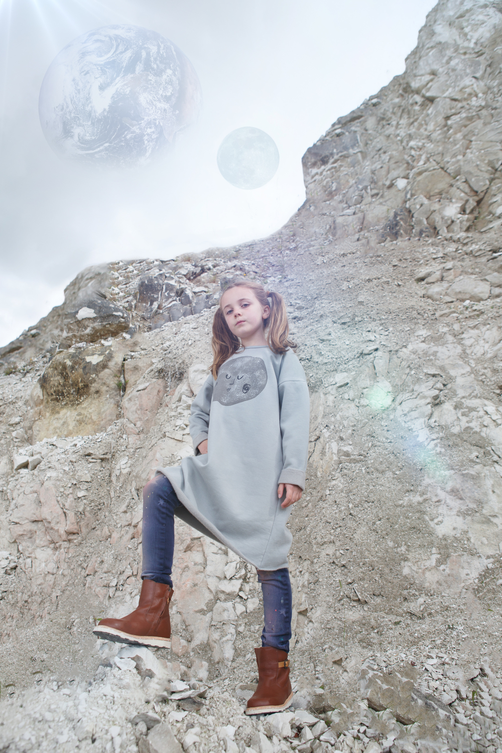Moon print grey dress, Bobo Choses. Star print jeans, Scotch R'Belle. Brown boots, Young Soles.