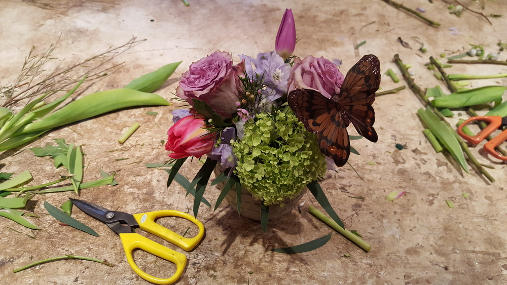 Adding butterflies to the design. All in One Season Dutch floral party workshop