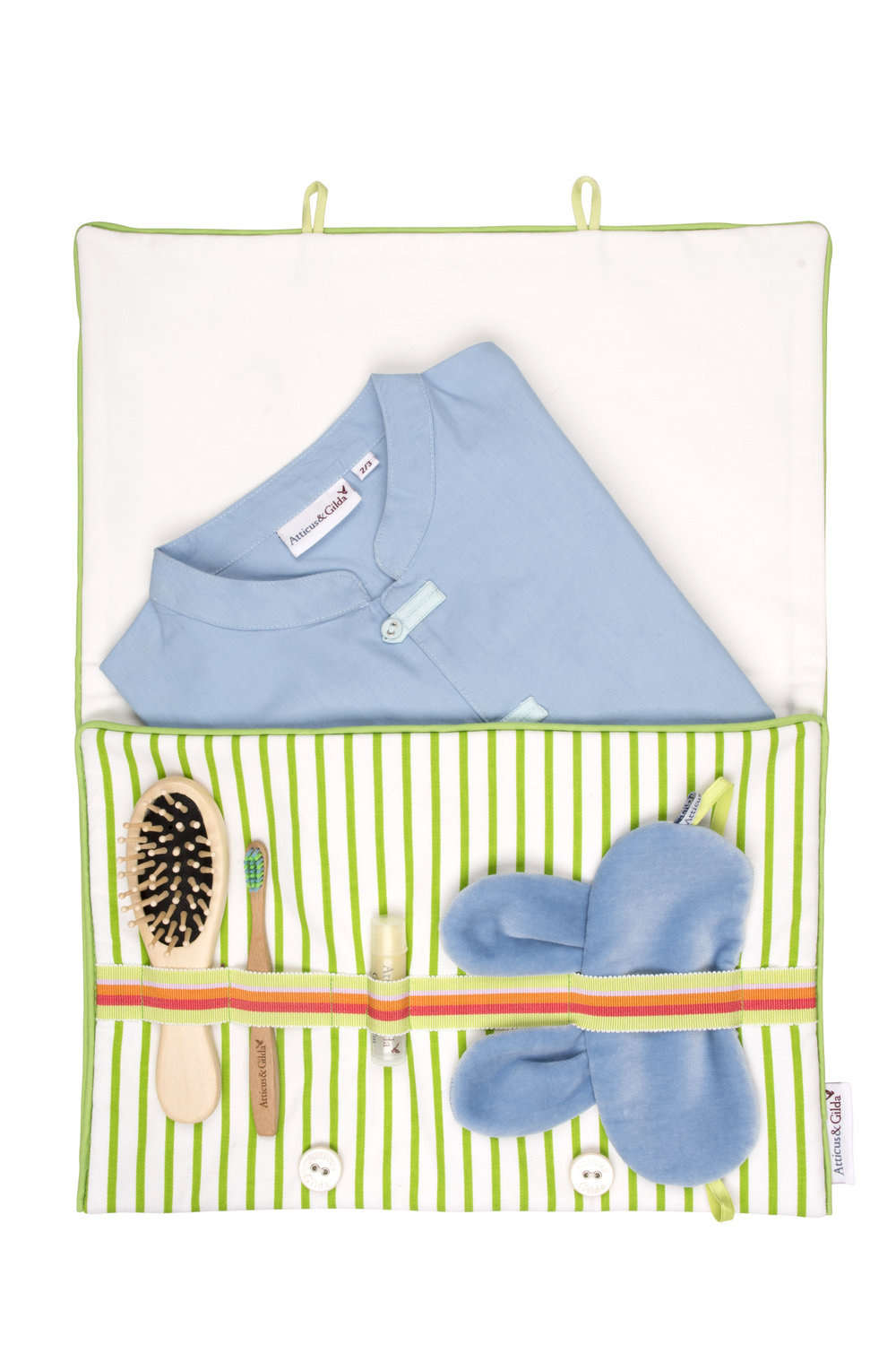 Atticus and Gilda pyjama overnight bag with brush, pyjamas, toothbrush, lip balm and sleep mask