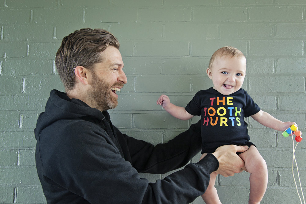 Father of daughters with daughter wearing the tooth hurts Lara and Ollie and Parent Apparel collaboration
