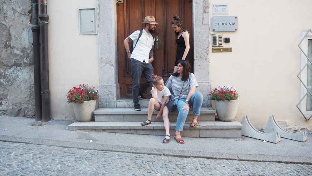 Airbnb Slovenia trip. Cascarina family outside their Airbnb appartment
