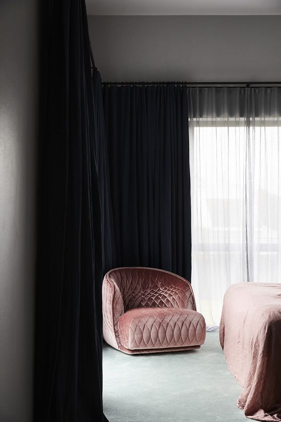 Velvet pink armchair in a bedroom