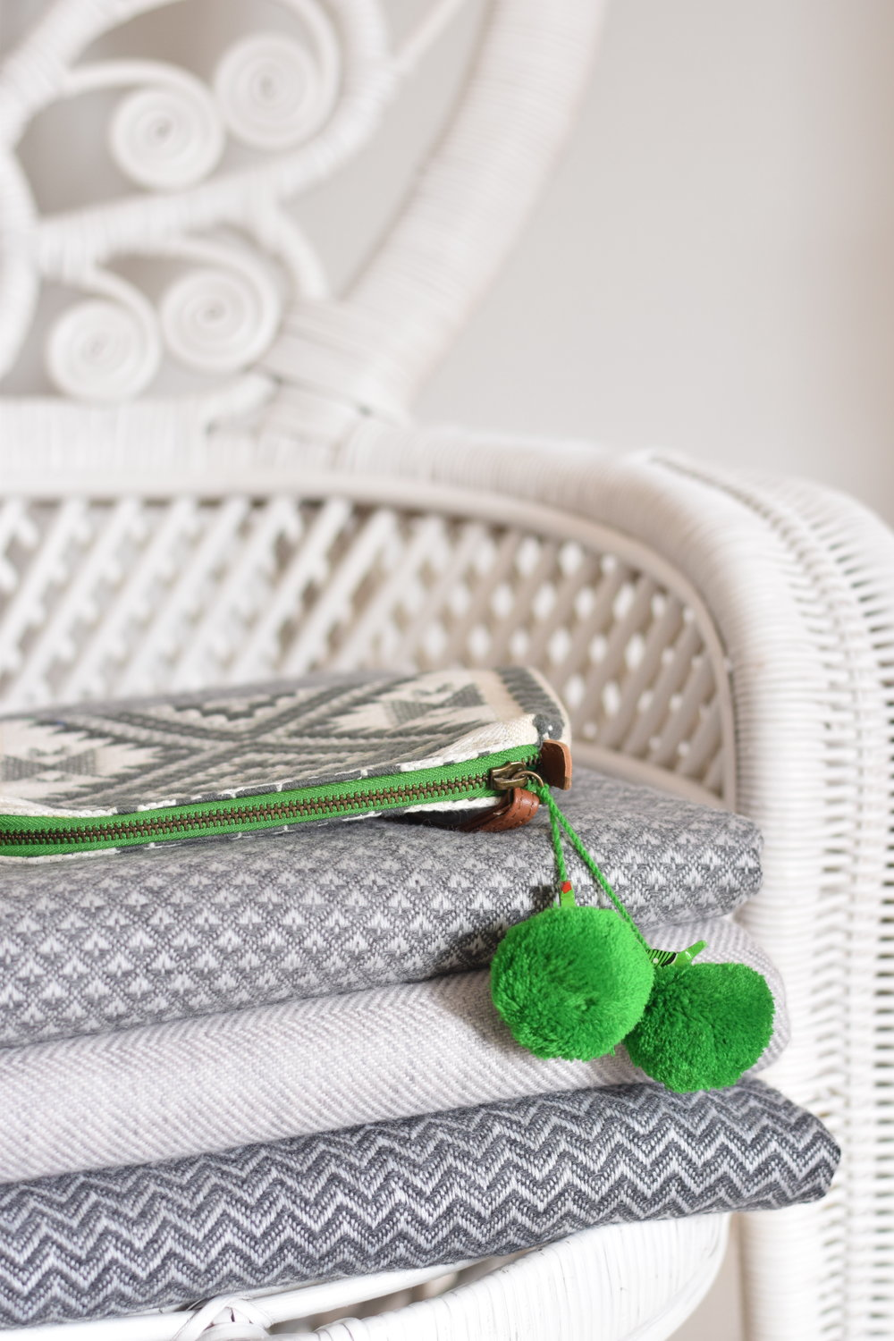 Dilli Grey cashmere pouch with green pompoms