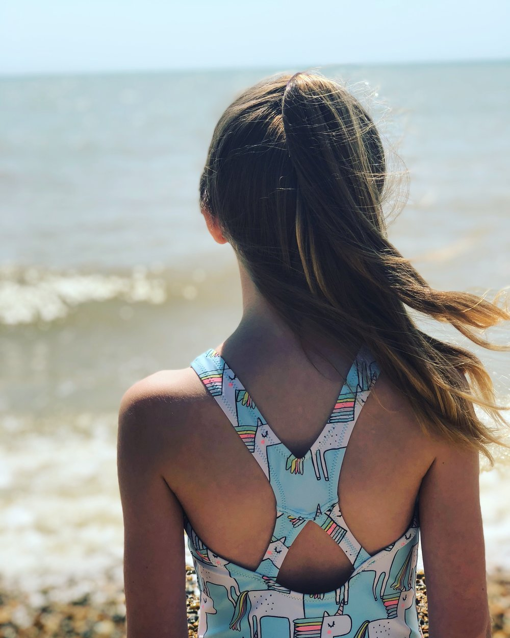 Ready Camp UK Unicorn swimsuit on the beach in Eastbourne