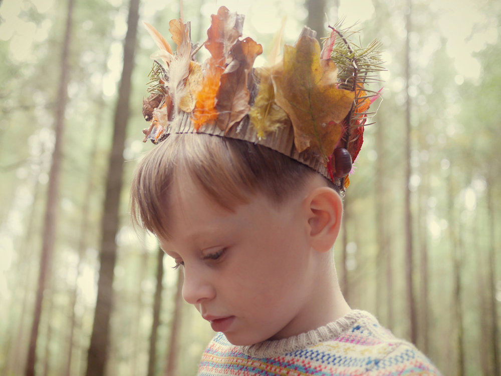 The Faraway Gang boy in leaf crown and knitted jumper