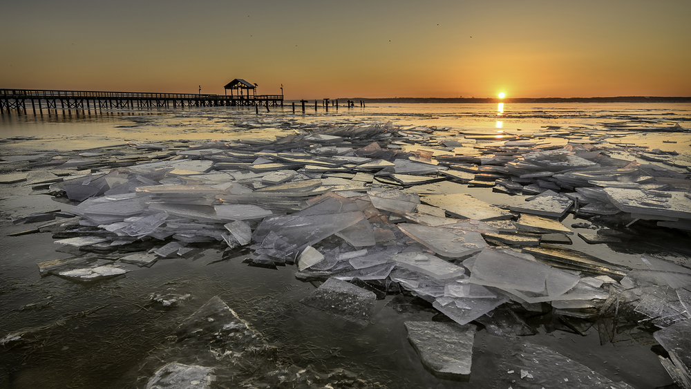 Sunrise on the icy banks of the Potomac River at Leesylvania State Park by Michael Donahue