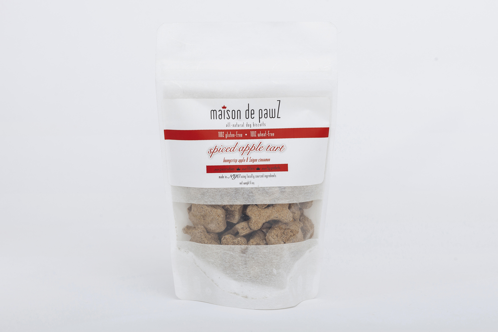 S P I C E D  A P P L E  T A R T ,  $ 1 2.50 Net Weight 6 oz. When you open a bag of spiced apple tart treats for your dog, you will bring the warm smells of spices and baked apples into your home. Why should your dog be left out of enjoying dessert with you? Made with Saigon cinnamon to keep your pup's breath fresh and soothing ginger for rumbling tummies, this is a perfect healthy & low fat treat for your dog. After all, an apple a day keeps the vet away!!  Shapes: signature crown, apple, bone Ingredients: Organic buckwheat flour, honeycrisp apples, ground Saigon cinnamon, ground cloves, ground ginger, fresh lemon juice