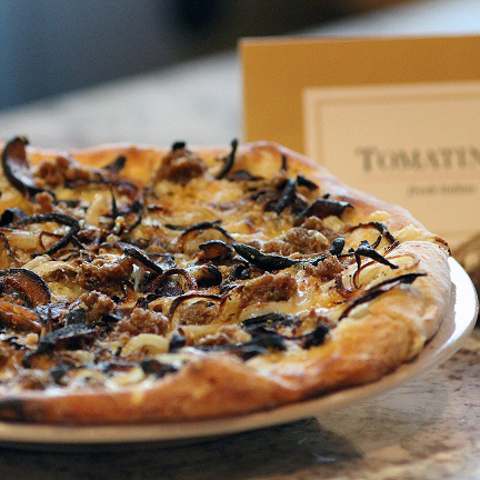 Our January Special pizza features roasted shiitake mushrooms, sautéed onions, fennel sausage, fontina, fresh thyme and Parmesan! Don't miss it! #tomatina
