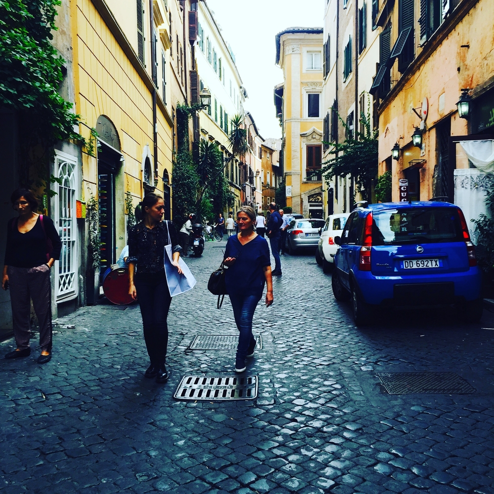 women walking in rome italy vacation trip
