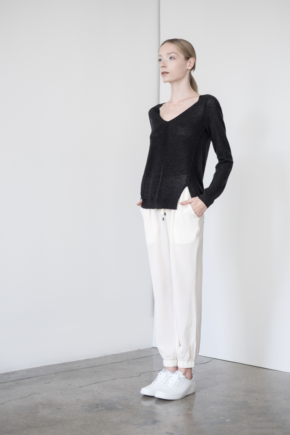 LOOK 39   TOP:   2276  / Noir   -     Audrey open mix lace stitch pullover, in fine gauge cashmere.   BOTTOM:   2203  / Bone -    Jogger pants in 100% Silk.