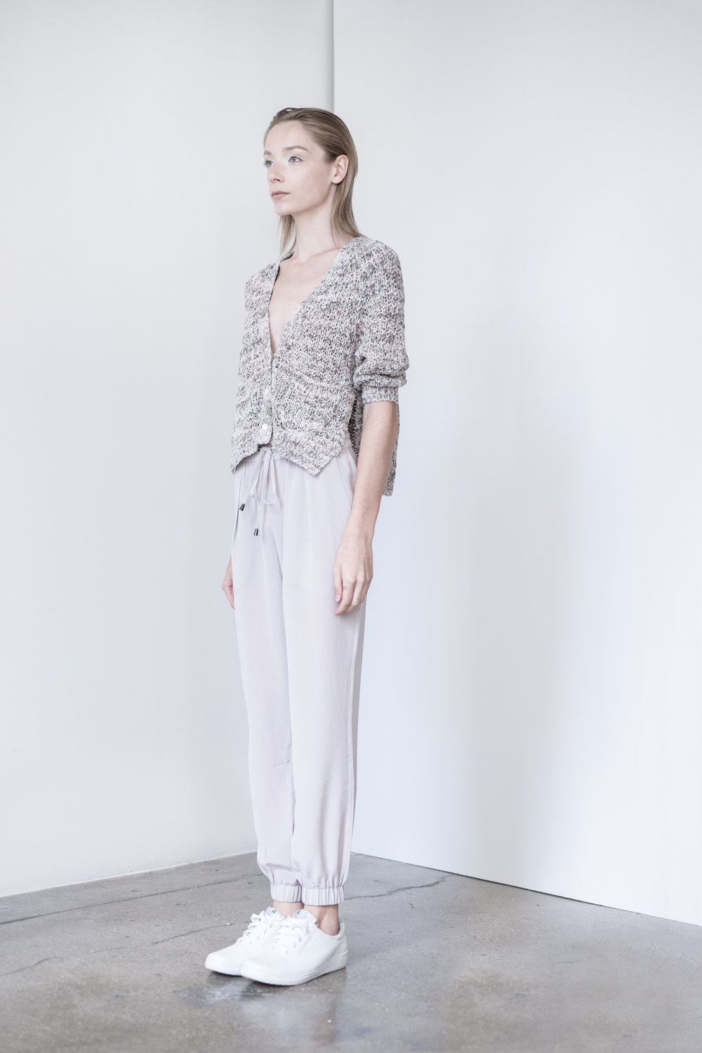 LOOK 18   TOP:   2302  / Marled Timber  -    Shrunken high slit vee cardigan, in printed cotton, nylon. WS: 105   BOTTOM:   2203  / Dove -    Jogger pants in 100% Silk.