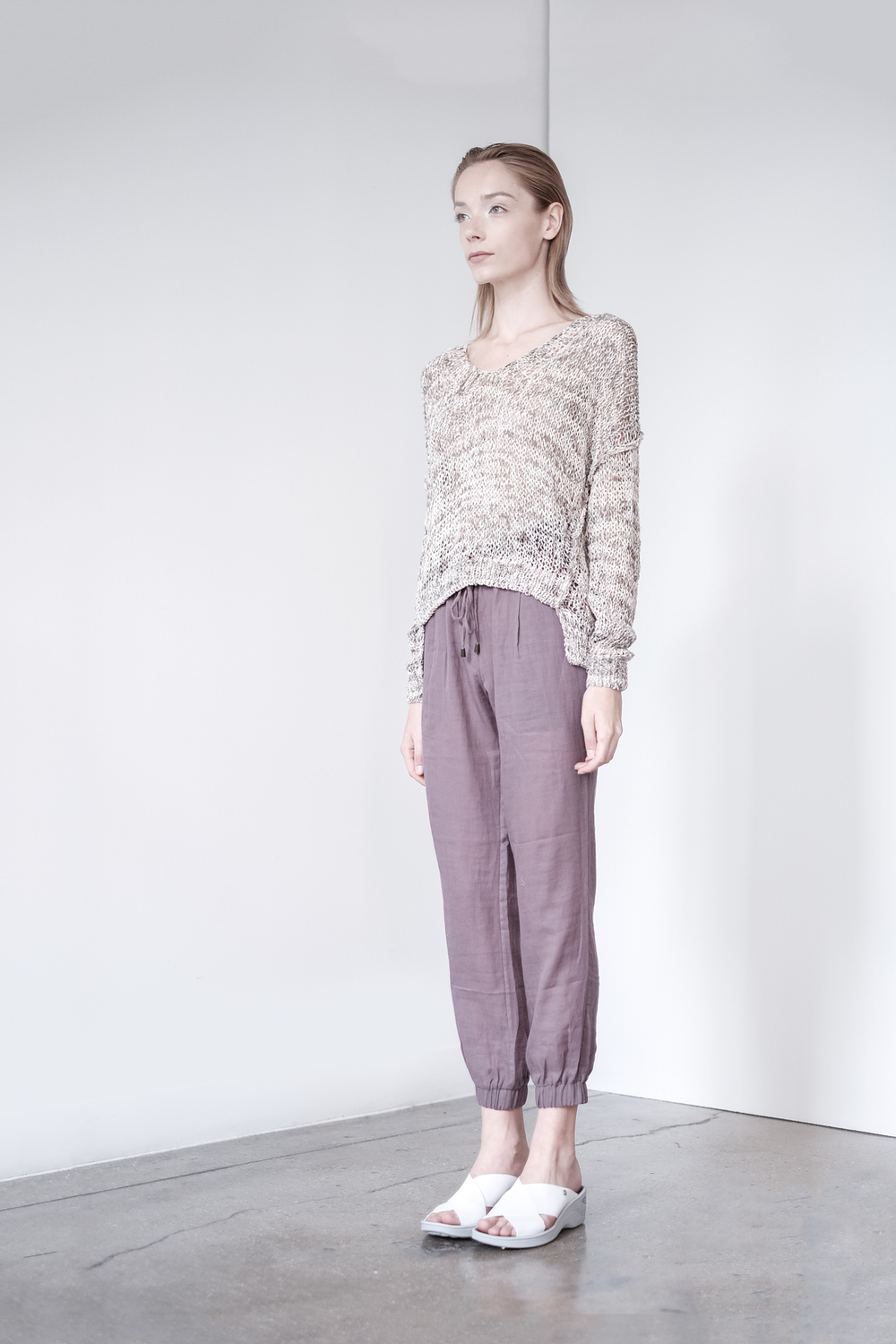 LOOK 20   TOP:   2299  / Marled Timber  -     Kate open knit slouchy pullover, in printed cotton, nylon.   BOTTOM:   2290  / Cinder  -   Jogger pants in 100% Cotton woven dbl. layer gauze.