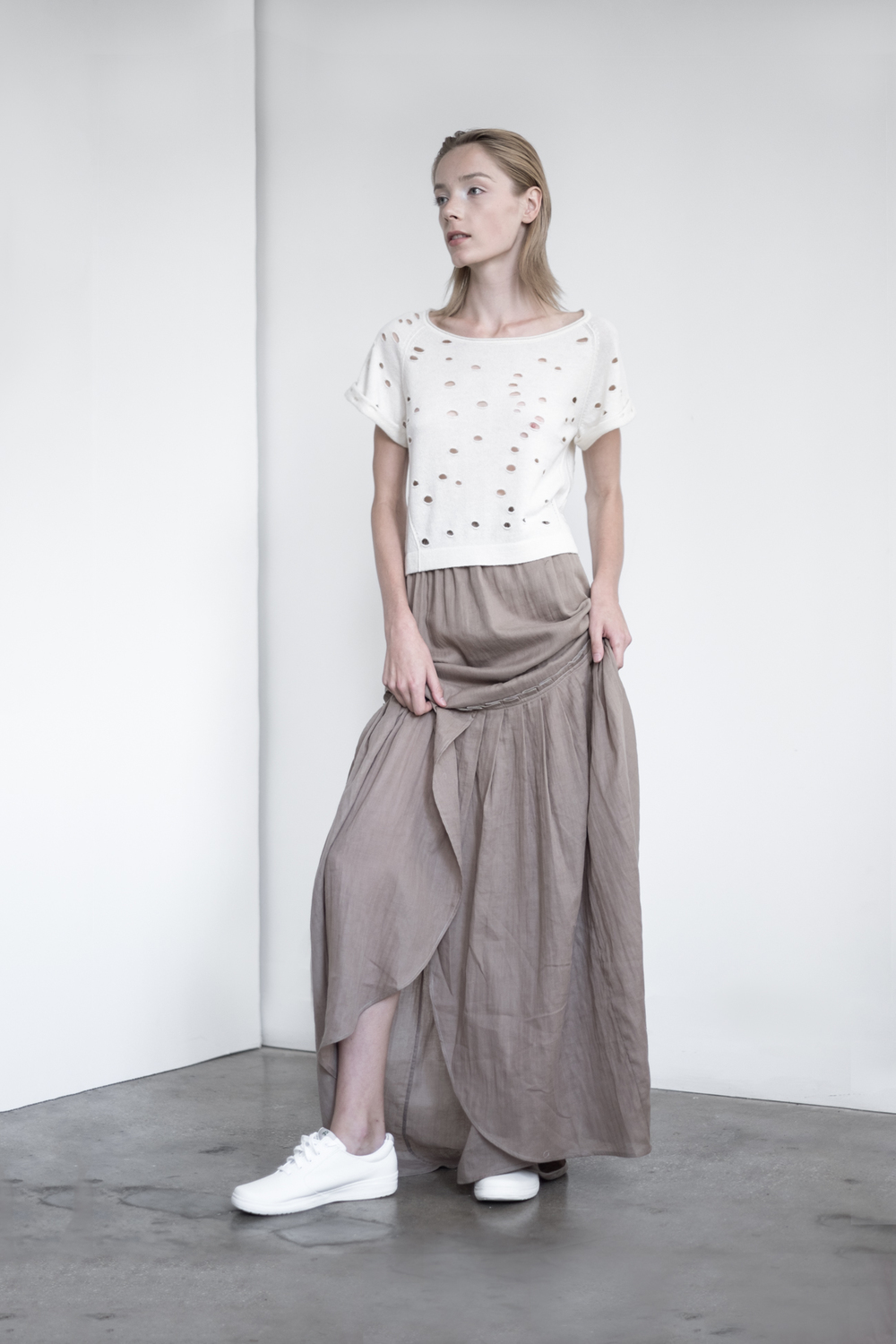 LOOK 31   TOP:  2296 / Bone  - Rolled short sleeve with engineered cut outs in fine gauge cashmere.   BOTTOM:  2291 / Timber - Long maxi skirt also can be worn as strapless dress, in crinkle woven 2-layer cotton gauze.