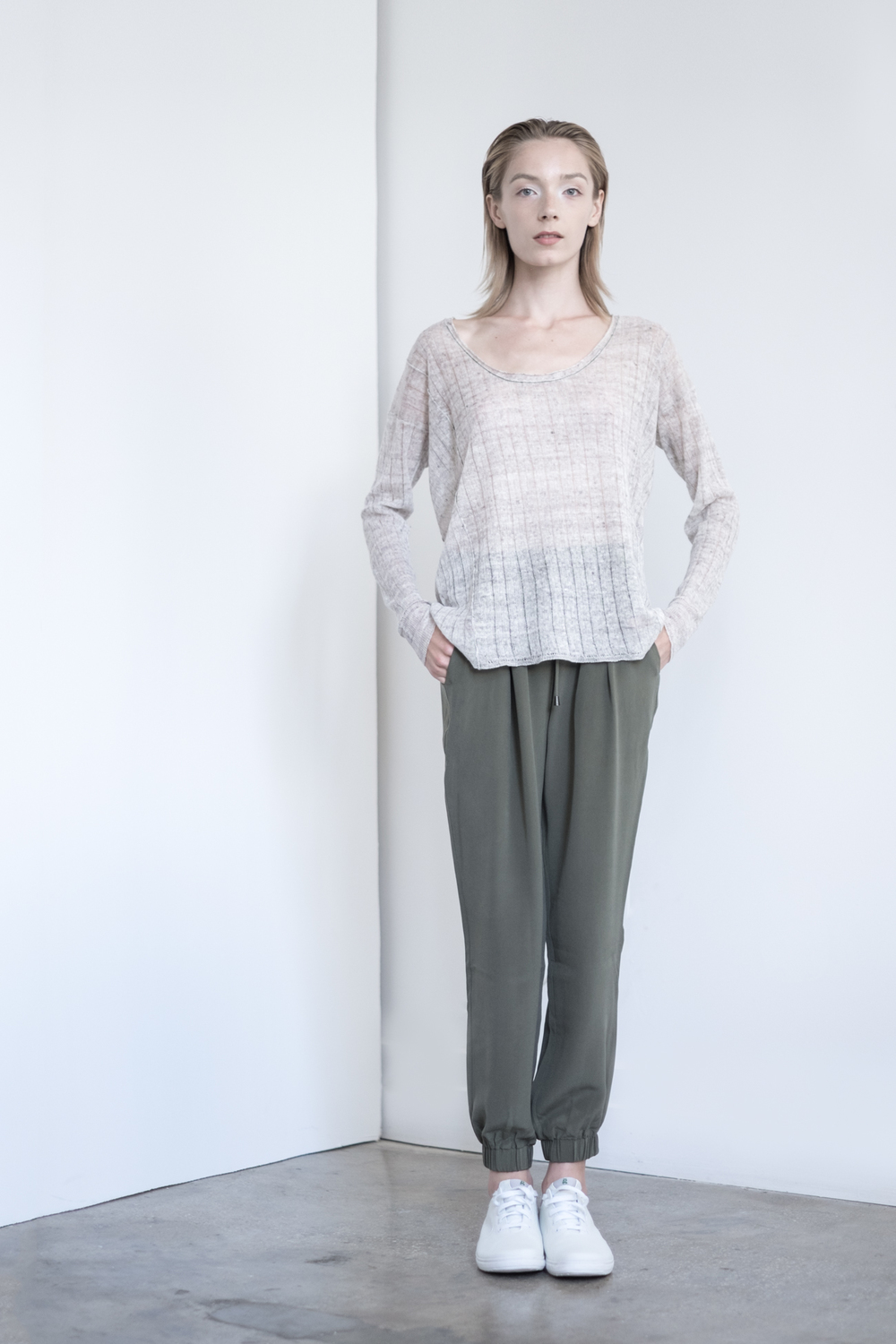LOOK 32   TOP:   2230  / Sand   -    Scoop neck long sleeve, in fine gauge Italian linen neps.   BOTTOM:   2203  / Clover -    Jogger pants in 100% Silk.