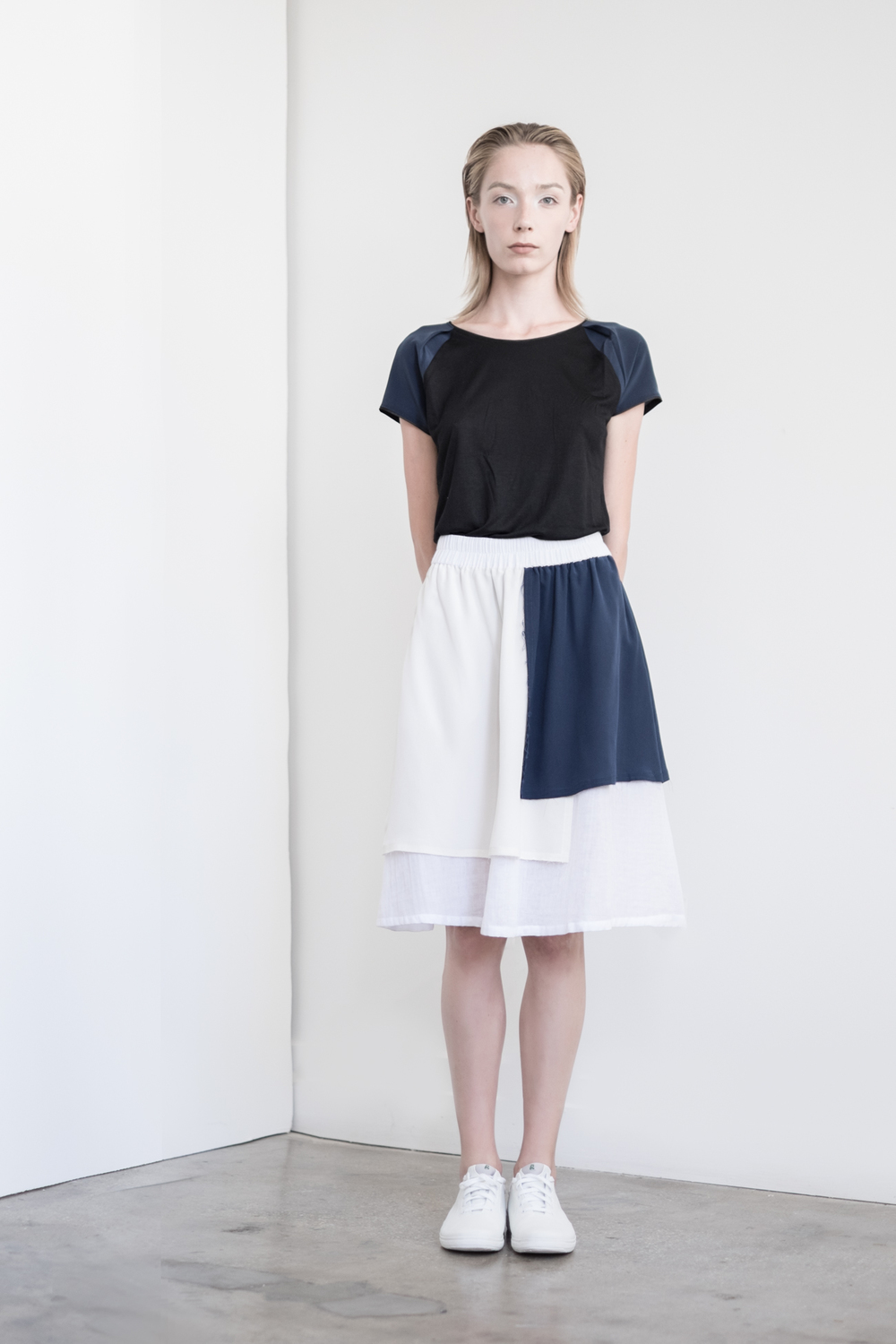 LOOK 35   TOP:   2285  / Noir   -     Short sleeve silk & viscose color block T-shirt.   BOTTOM:   2293  / Blanc Combo -     Curator skirt in silk crepe de chine color block paneling.