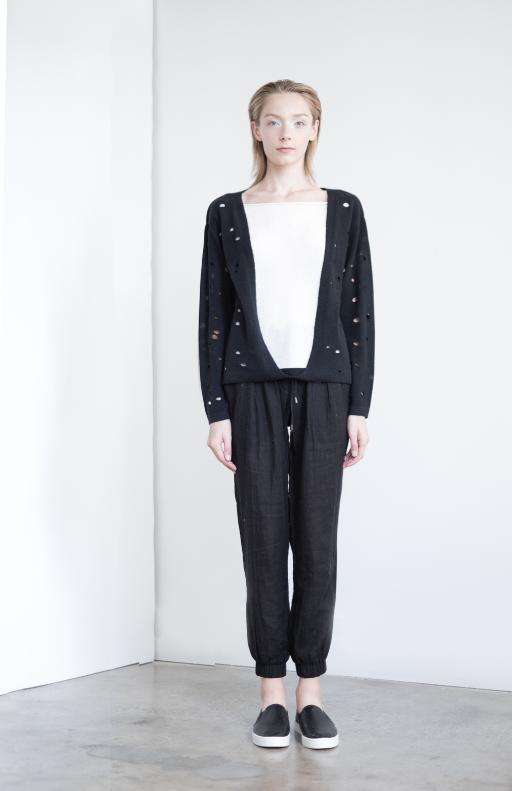 LOOK 37   TOP:   2295  / Noir   -     Engineered cut outs with overlay, in fine gauge cashmere. WS:  163   BOTTOM:   2290  / Noir  -   Jogger pants in 100% Cotton woven dbl. layer gauze. WS:  88