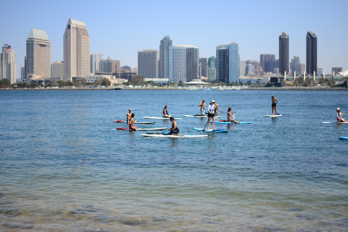FitFest participants taking an awesome yoga stand up paddle boarding class