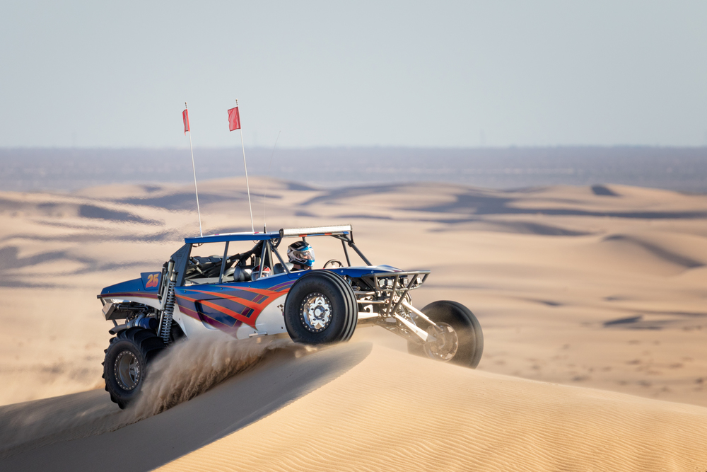 People come from all over to drive on these dunes. This sand rail is being driven by Scott Rueschenberg of JPU Racing. He's taking his son for a spin.