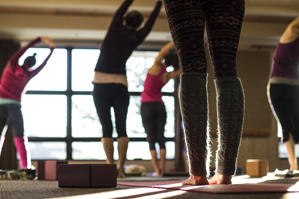 Morning yoga at the Ski and Yoga Retreat. Photo by  Hannah Dewey Photography