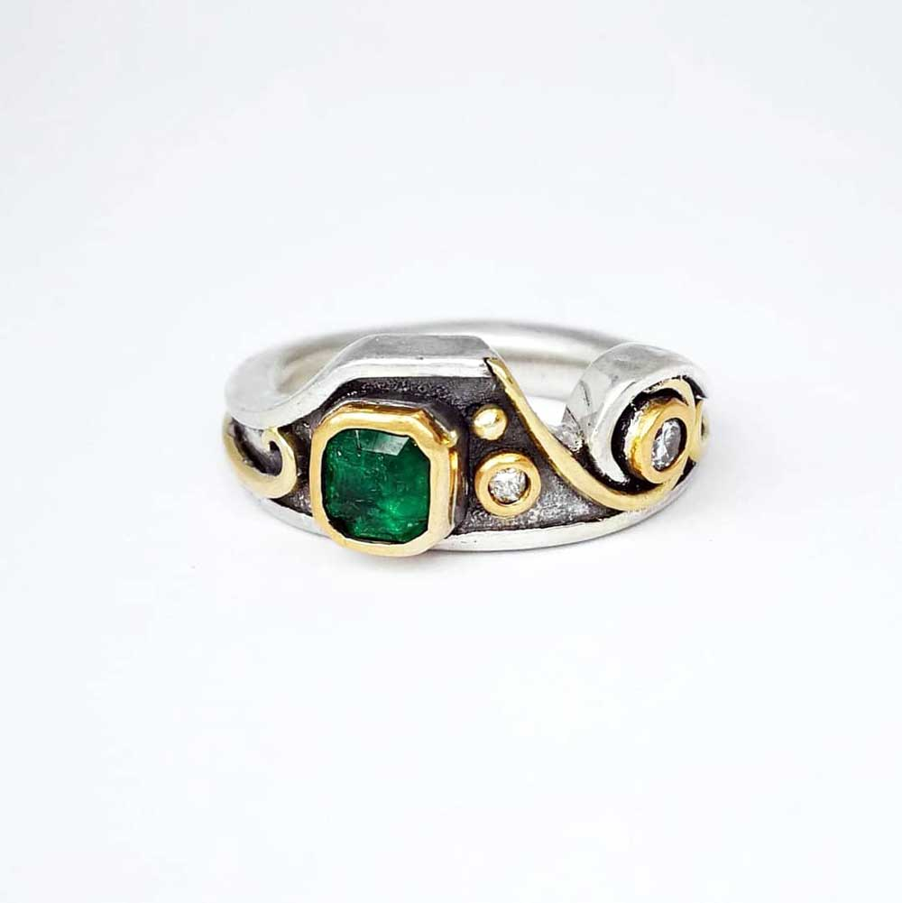 Upcycled Emerald and diamond ring.