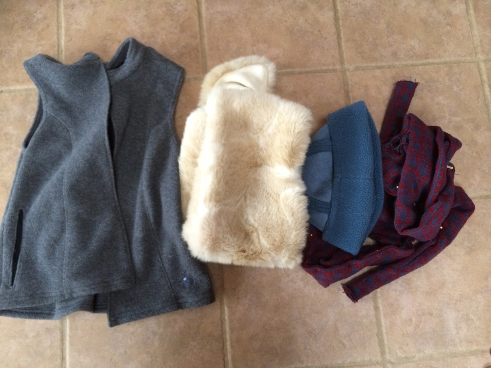 The raw materials! Vest, fur, hat, knit belt. The navy blue underclothes (boys'  turtleneck and sweat pants) didn't require any effort beyond washing!
