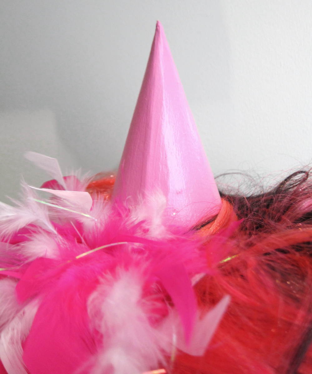 HOT PINK: thrift store wig and part of a pink feather boa