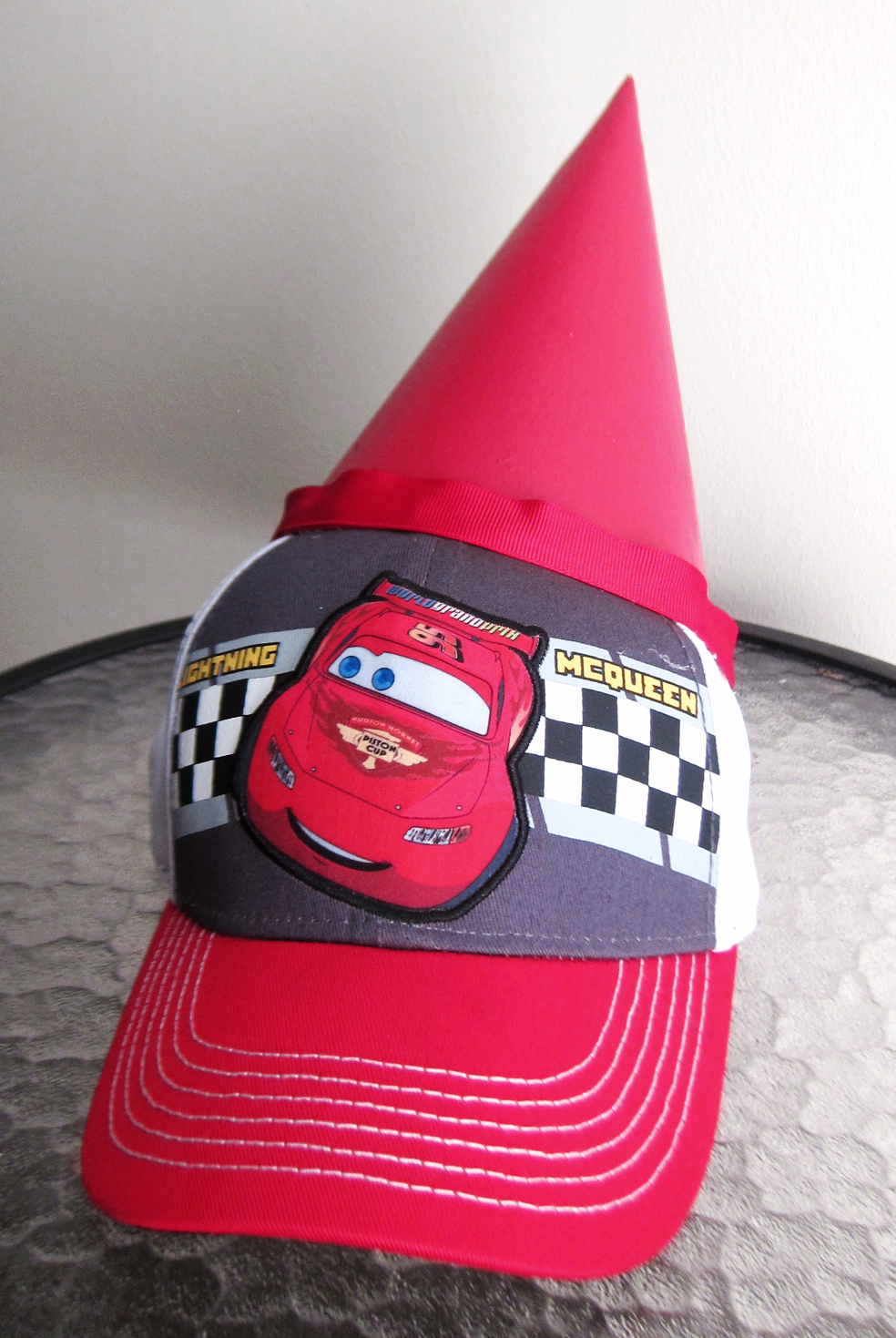 RACE CAR RED: Lightening McQueen hat from the halloween store, red ribbon that I had leftover from another project.