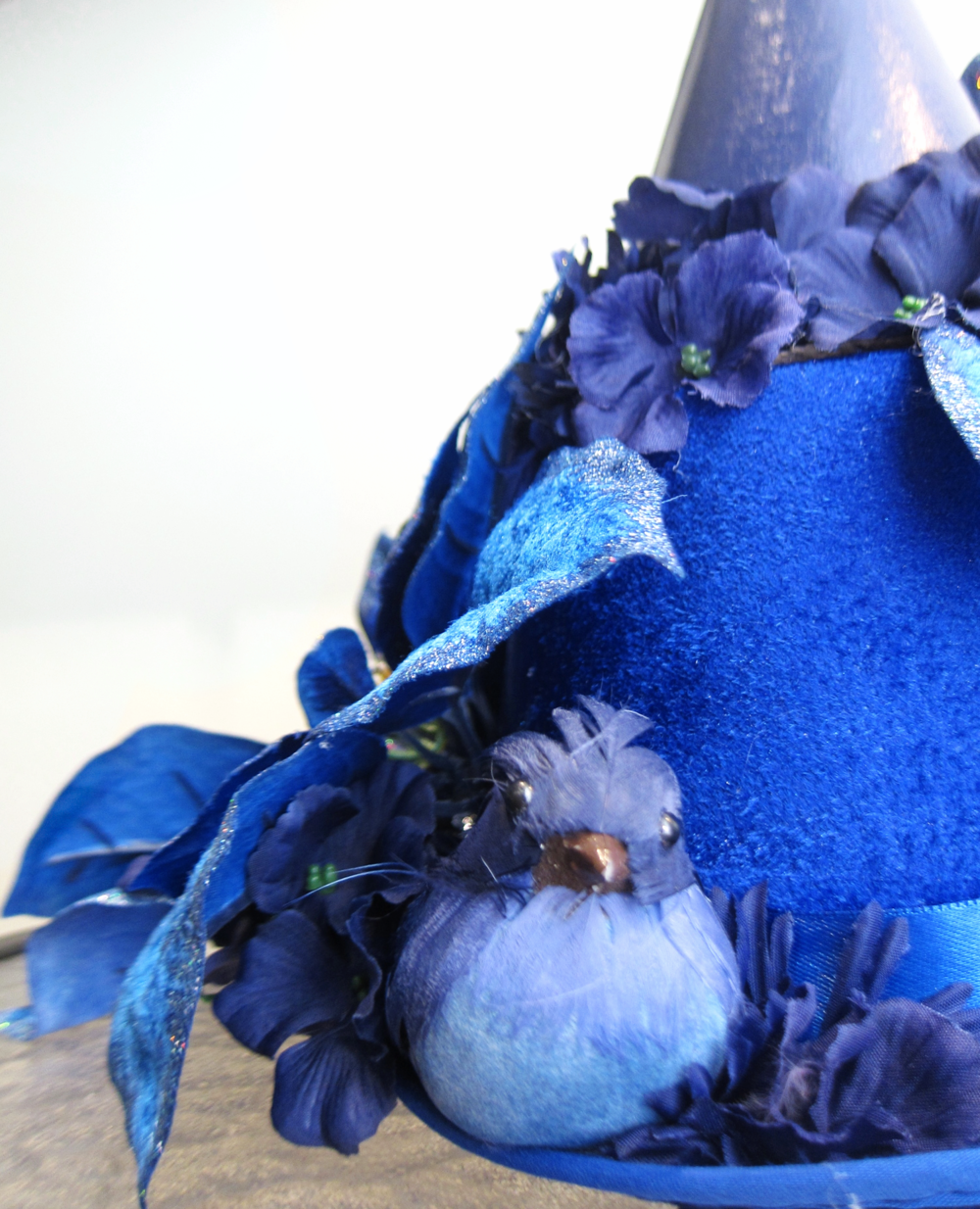 Halloween shop hat, craftstore flowers and birds