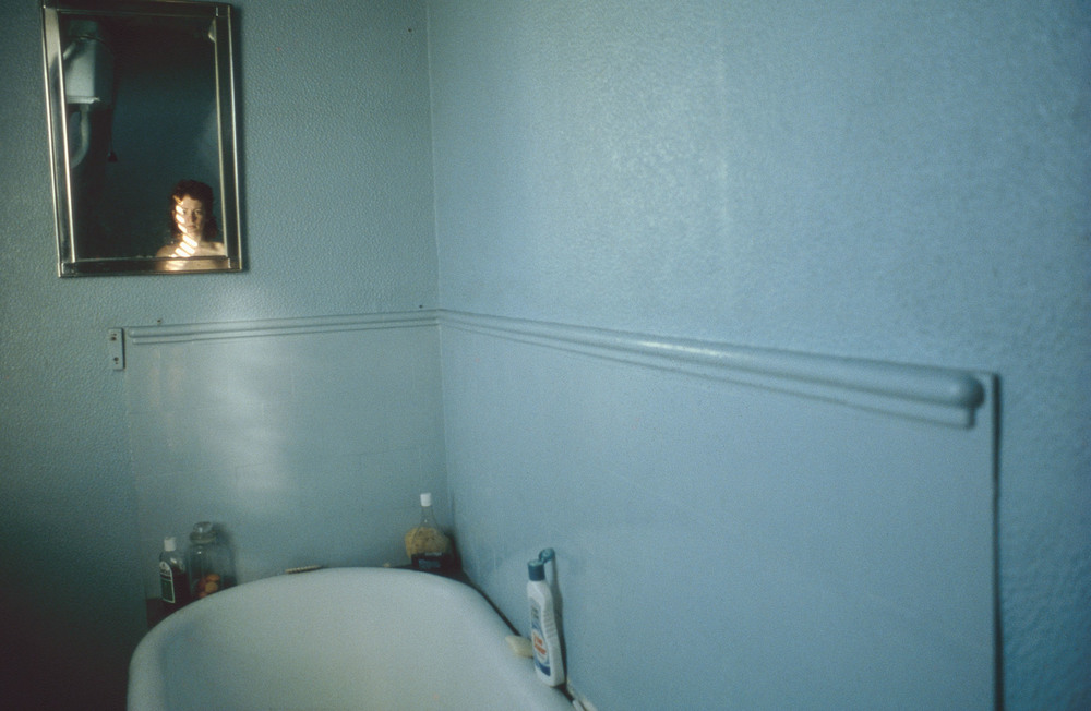 Nan Goldin, Self Portrait in the Blue Bathroom, London, 1980
