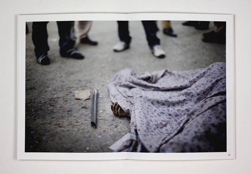 91. The corpse of a civilian who appears to have been an innocent bystander lies in the street after a gun battle in central Kabul. Three suicide bombers attacked a police station, killing nine and injuring ten others. 18th June 2011, Kabul, Afghanistan