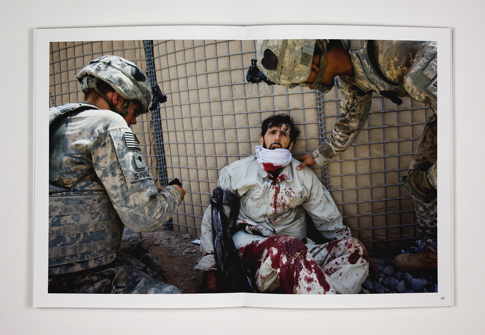 143. American medics based at Forward Operating Base Howz-e-Madada treat a severely injured Afghan employee of a private security company. The afghan militiaman was guarding a NATO supply convoy when it was ambushed by the Taliban. 17. July 2010. Zhari District, Kandahar Province, Afghanistan