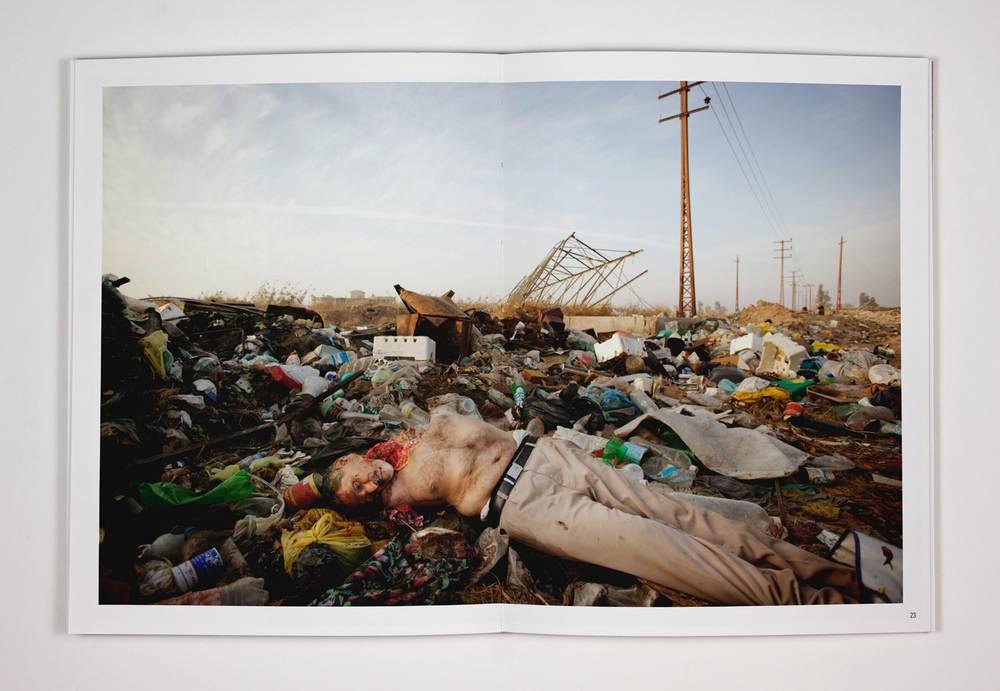27. The second of two dead men found by Iraqi soldiers on piles of trash at the side of the road just outside Ghazaliya. Parts of the body had been eaten by the wild dogs that roam Baghdad. 21 December 2006. Baghdad, Iraq