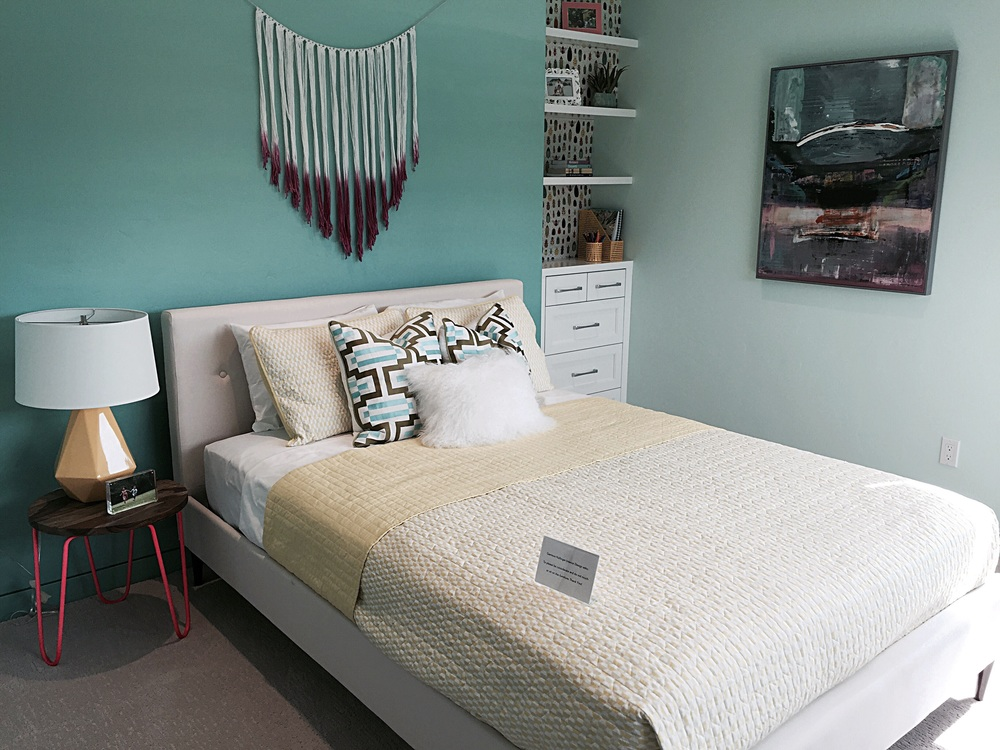Playful teen girls room with wall color that was ombre.