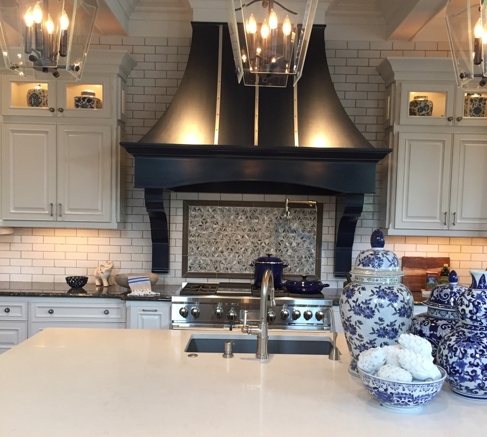 There were a lot of contemporary kitchens...this one proved that white kitchens will be around for along time with this classic look.We saw variations of the subway tile throughout the homes.
