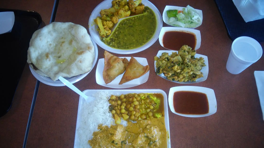 Chicken Curry, Chick peas and rice----------- Lentils and cauliflower--------Naan, Samosas and Pakora