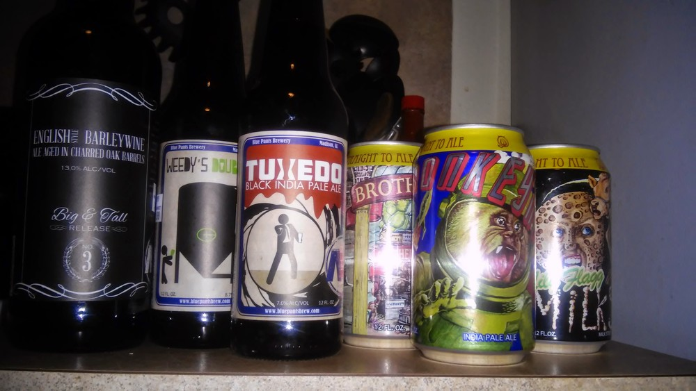 """(L to R) Blue Pants Brewery """"English Barley wine"""", """"Weedy's Double Knee"""", """"Tuxedo"""", Straight to Ale Brewery """"Brother Joseph"""", """"Monkeynaut IPA"""" and """"Lily Flagg"""""""