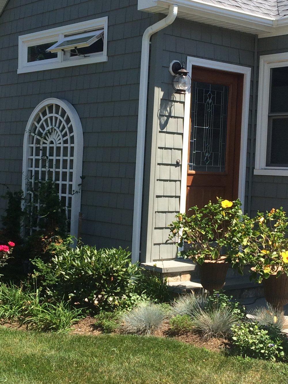 Enclose porch to create mudroom - After