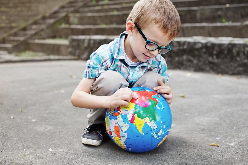 Male Child Wearing Fashion Eyewear playing