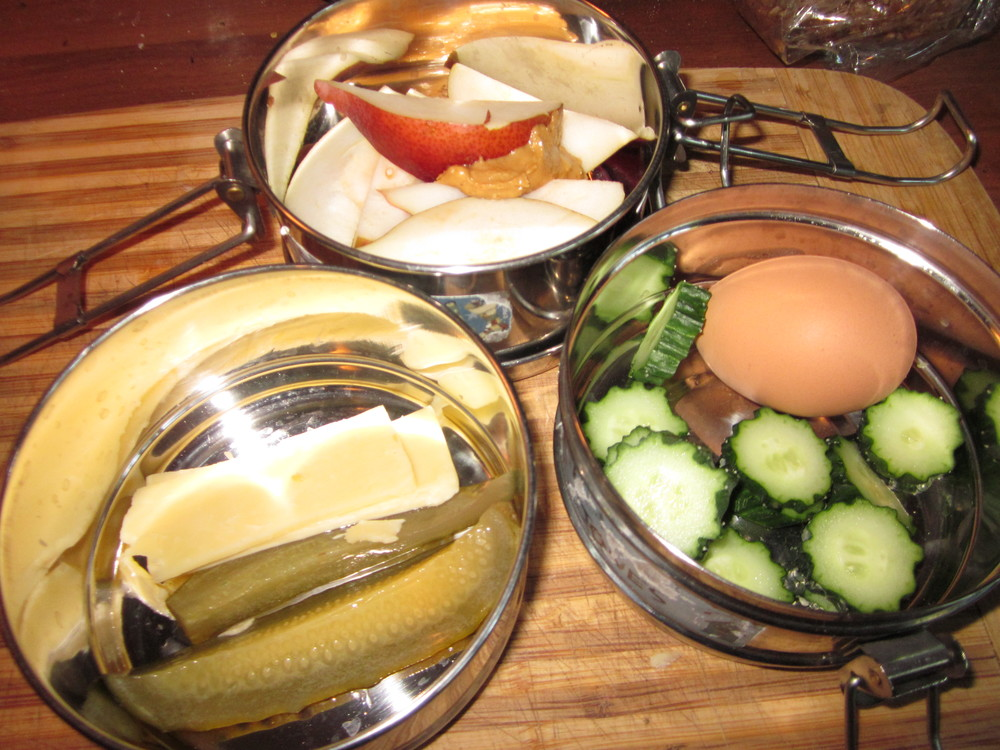 Homemade lacto-fermented pickles and cheddar cheese, apple slices and nut butter, garden cucumbers and a 9 minute egg.